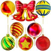 Set of golden Christmas-tree bells and balls — Stock Photo