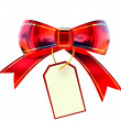 Red Christmas bow with label — Stock Photo