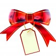 Red Christmas bow with label - Stock Photo