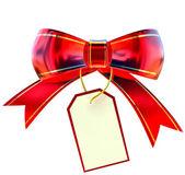 与标签的红色圣诞蝴蝶结 — 图库照片