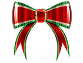 Red with green plastic gift bow — Stock Photo