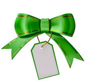 Green Christmas bow with label — Stock Photo