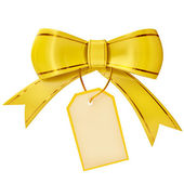 Yellow Christmas bow with label — Stok fotoğraf