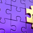 Last golden piece of metallic puzzle with keyhole — Stock Photo #15734541