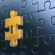 Last golden piece of metallic puzzle with keyhole - Stock Photo