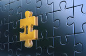 Last golden piece of metallic puzzle with keyhole — Stock Photo