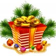 Christmas tree toys and gift with golden bow - Stock Photo