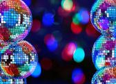 Colorful dark background with mirror disco balls — Stock Photo
