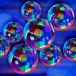 Colorful funky background with mirror disco balls - Stock Photo