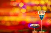 Two blue curacao cocktails and city illumination — Stock Photo