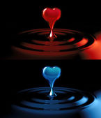 Falling heart shaped water drop into the water — Stock Photo