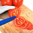 Stock Photo: Slicing tomato