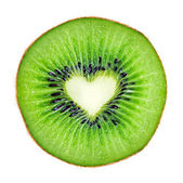 Heart shape slice kiwi fruit macro — Stock Photo