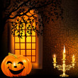 Candle in a candlestick and a pumpkin on a background window on — Stock Vector