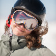 Young Woman Snowboarder Smiling on Snowy Mountain - Stock Photo