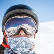 Stock Photo: Portrait of a snowboarder in the mountains