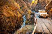 Soviet SUV UAZ in the Caucasus mountains on a mountain road — Stock Photo