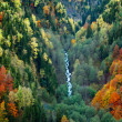 Slopes autumn mountains and waterfall — Stock Photo