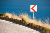 Road sign on Winding Road — Stockfoto