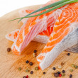 Stakes from salmon with green onions and spices on chopping board — Stock Photo #12570840