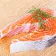 Stake from salmon on wooden chopping board — Stock Photo #12570843