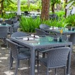 Free little tables in street cafe in tropics — Stock Photo