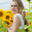 Stock Photo: Happy mother with the daughter in the field with sunflowers