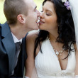 Kiss of the groom and the bride on wedding picnic — Stock Photo