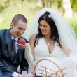 Bride treats the groom with a ripe peach — Stock Photo