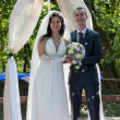 Newly-married couple after ceremony of wedding - Stockfoto