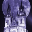 Prague, Virgin Mary church before Tyn in a full moon - Stock Photo