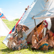 North AmericIndians sit at wigwam — Stock Photo #13579025