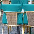 Brown wicker chairs in street cafe — Stock Photo