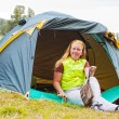 Stock Photo: Girl has rest in green tent against mountains