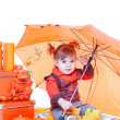 Stock Photo: Girl in orange vests with an orange umbrella