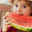 Little girl in straw hat with appetite eats ripe water-melon — стоковое фото #13579676