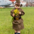 Little girl in a military uniform against planes — Foto de Stock