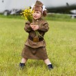 Little girl in a military uniform against planes — Stock Photo #13579693