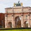 PARIS-OCT 02:Triumphal Arch (Arc de Triomphe du Carrousel) at Tuileries gardens in Paris,France on October 02,2012 — Stock Photo #14080243