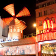 Stock Photo: PARIS - OCT 2: Moulin Rouge by night, on October 2, 2012 in Paris, France