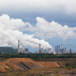 Thermal power plant against an open coal pit — Stock Photo #14080655