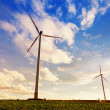 Green renewable energy concept - wind generator turbines in sky — Stock Photo #14080672