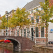 Colorful street with canals in old town of Delft, Holland — Stock Photo #14080723