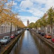 Beautiful view of channels in Delft (Netherlands) in sunny autumn day - Stock Photo