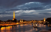 PARIS - OCT 1: Eiffel Tower and Pont Alexandre III at night on October 1, 2012 in Paris — Stock Photo