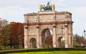 PARIS-OCT 02:Triumphal Arch (Arc de Triomphe du Carrousel) at Tuileries gardens in Paris,France on October 02,2012 — Stock Photo