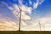 Green renewable energy concept - wind generator turbines in sky — Stock Photo