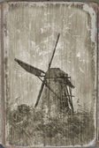 Windmill in Kinderdijk, Holland (processing under an ancient card) — Stockfoto