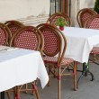 Wicker chairs and little tables at street restaurant — Stock Photo