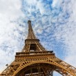 Eiffel Tower against the blue sky and clouds Paris France. — Stock Photo #16274063